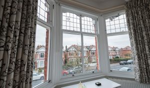 White timber bay vertical sliding windows interior view