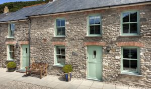 Chartwell green uPVC vertical sliding windows and door