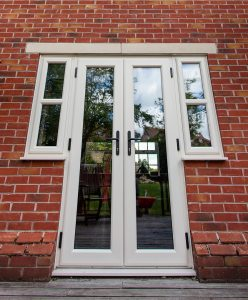 Cream uPVC french doors with black handles