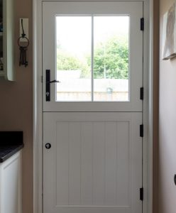 Interior view of a white timber stable door