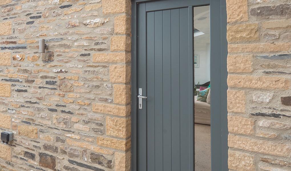 Modern grey timber entrance door