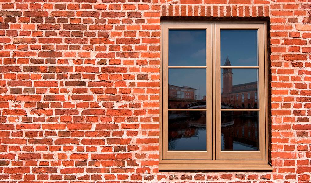 Oak effect uPVC flush sash window installation