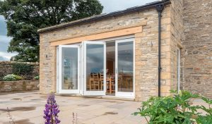 A white open timber bifold door