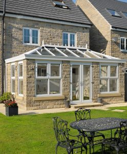 Large white uPVC orangery installation