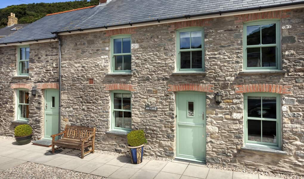 Chartwell green uPVC vertical sliding windows