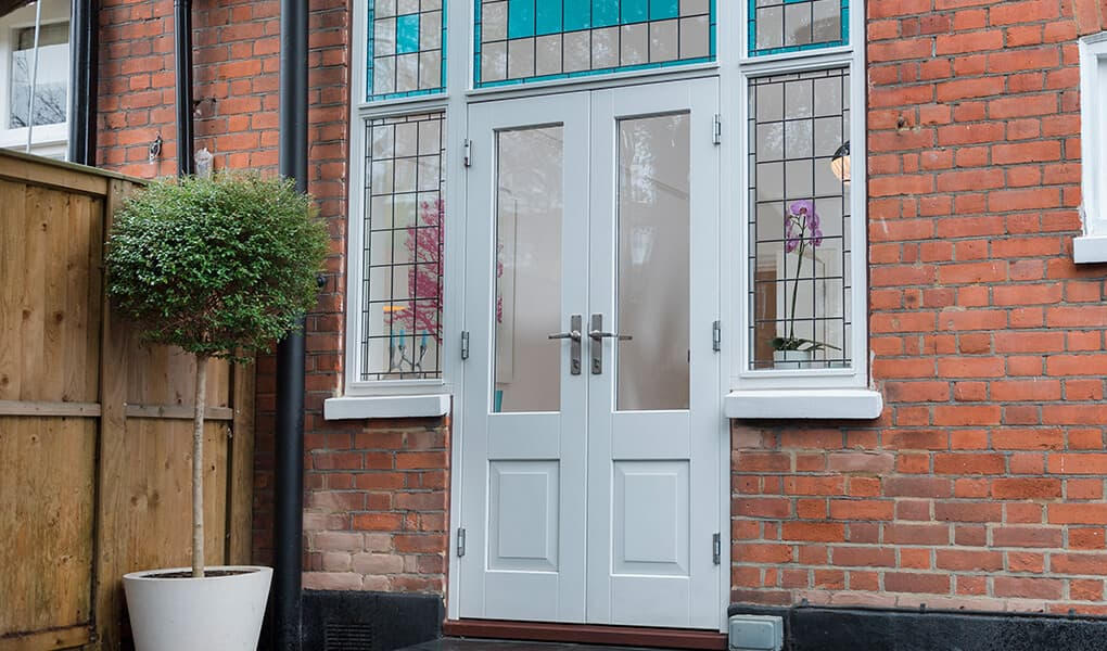 White timber French door installation