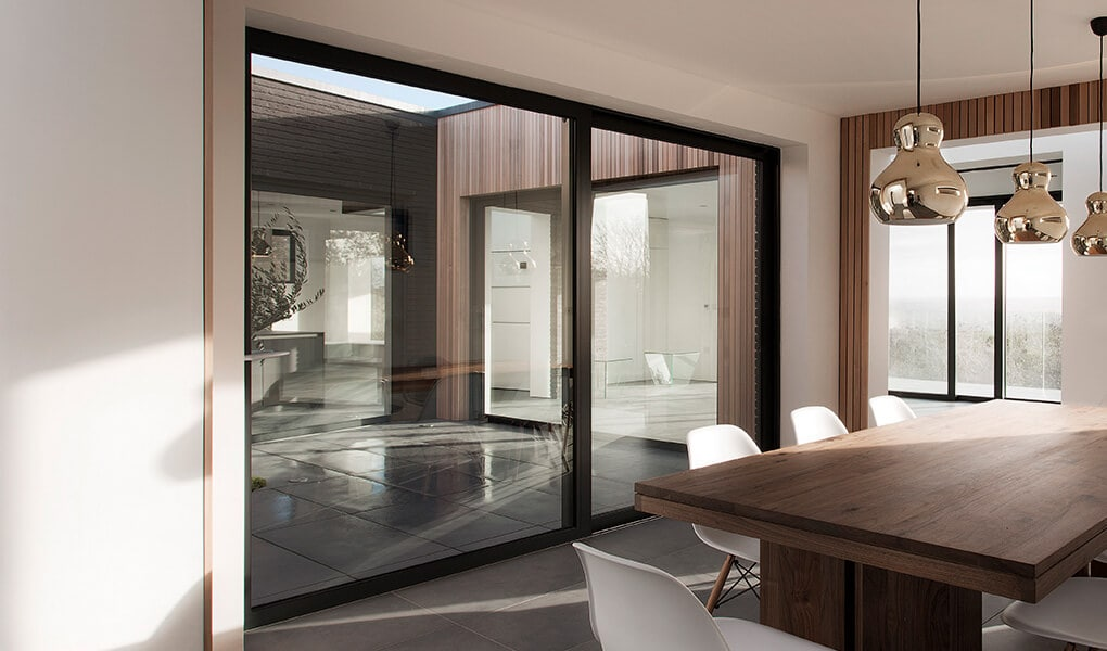 Large black aluminium patio door installation
