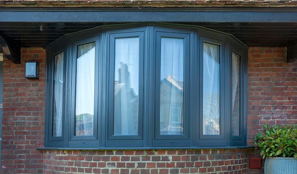 Black uPVC flush sash bow window