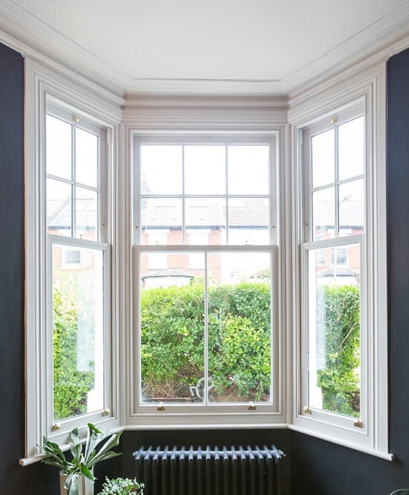 White timber bow vertical sliding windows