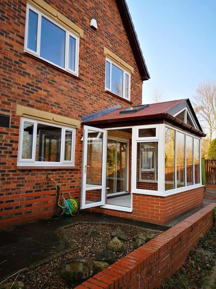 WarmerRoof Lean to tiled roof conservatory in brick red