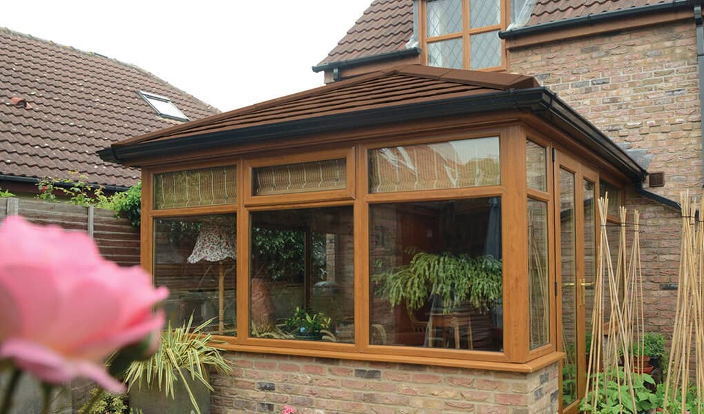 Oak effect Edwardian conservatory with a tiled Supalite roof