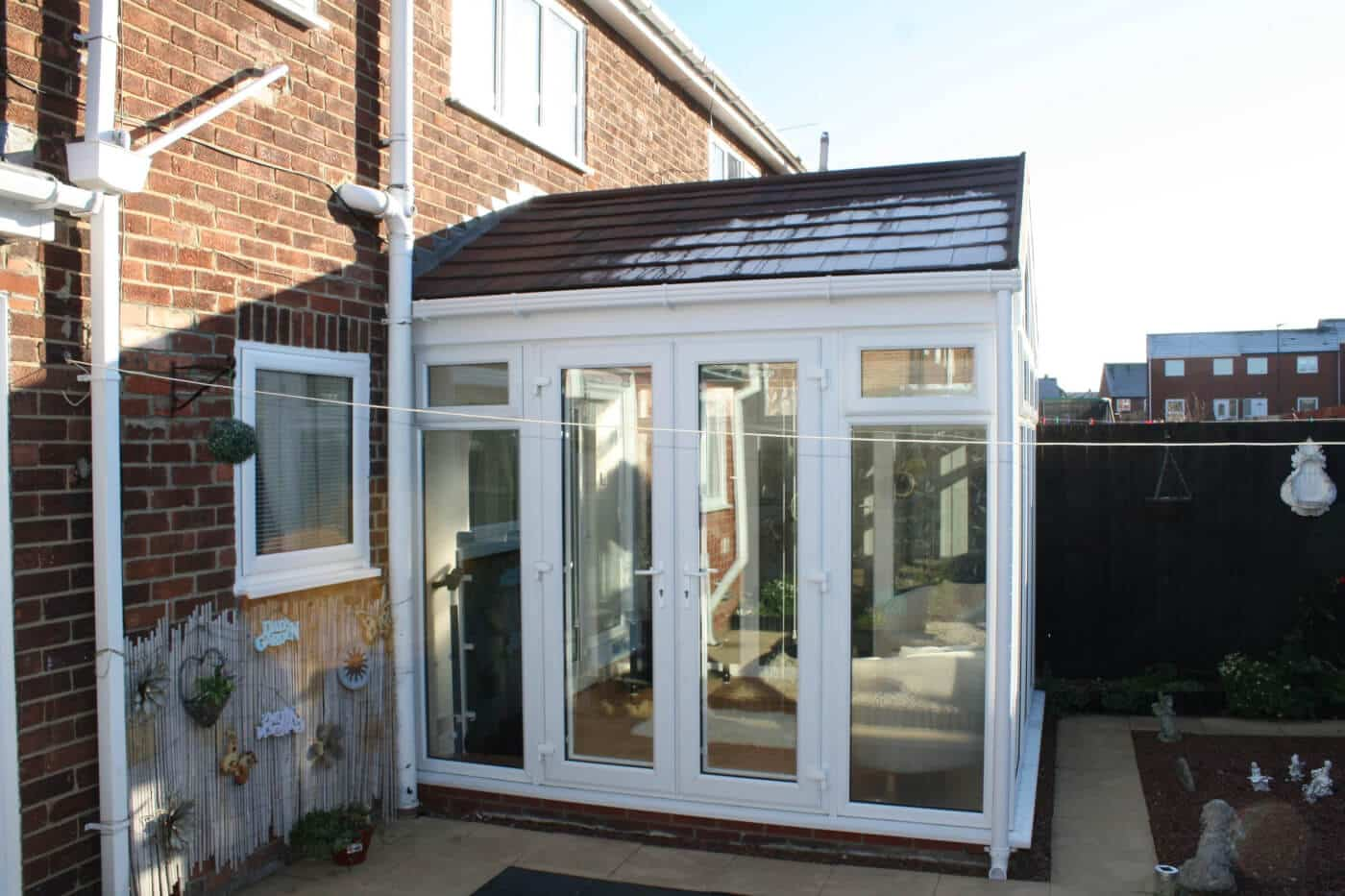 Gable conservatory with black tiled roof