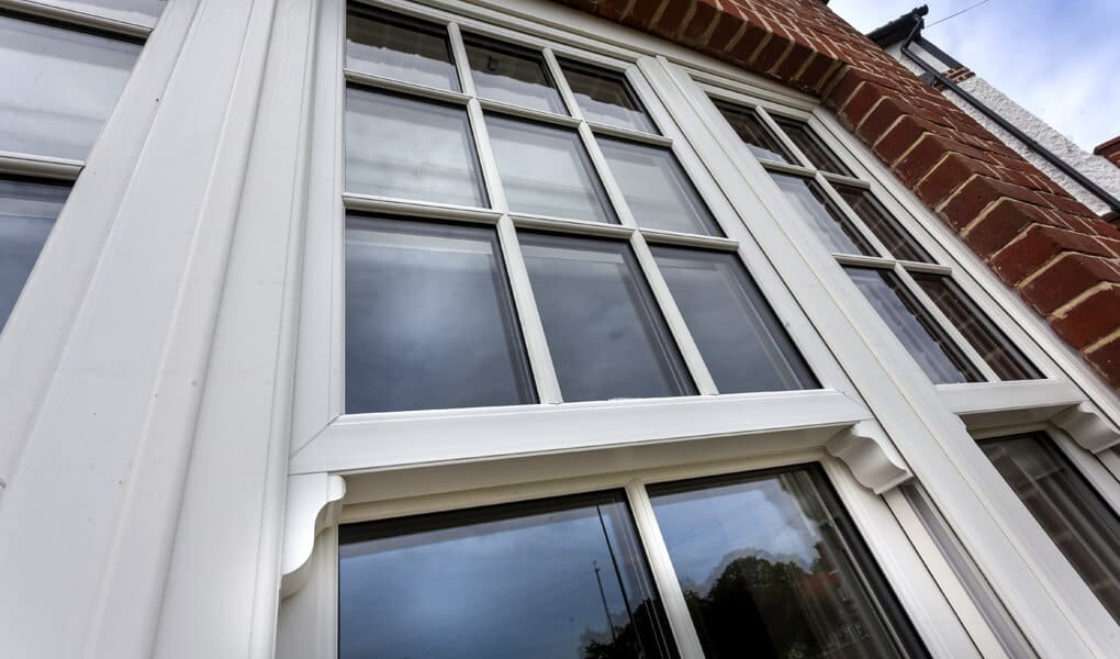 White uPVC vertical sliding window close up