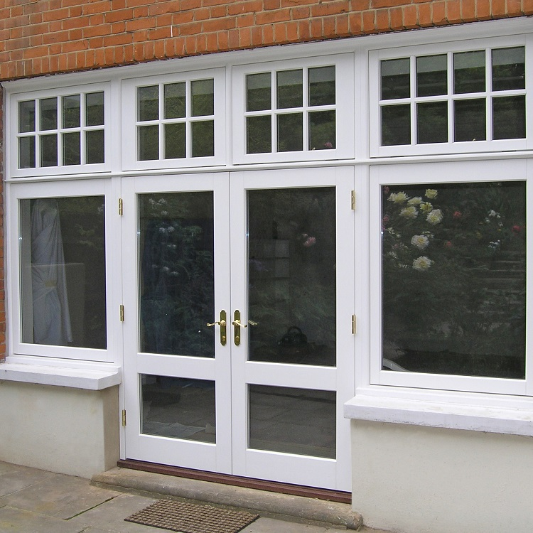 Traditional French doors with sidelights and astragal bars