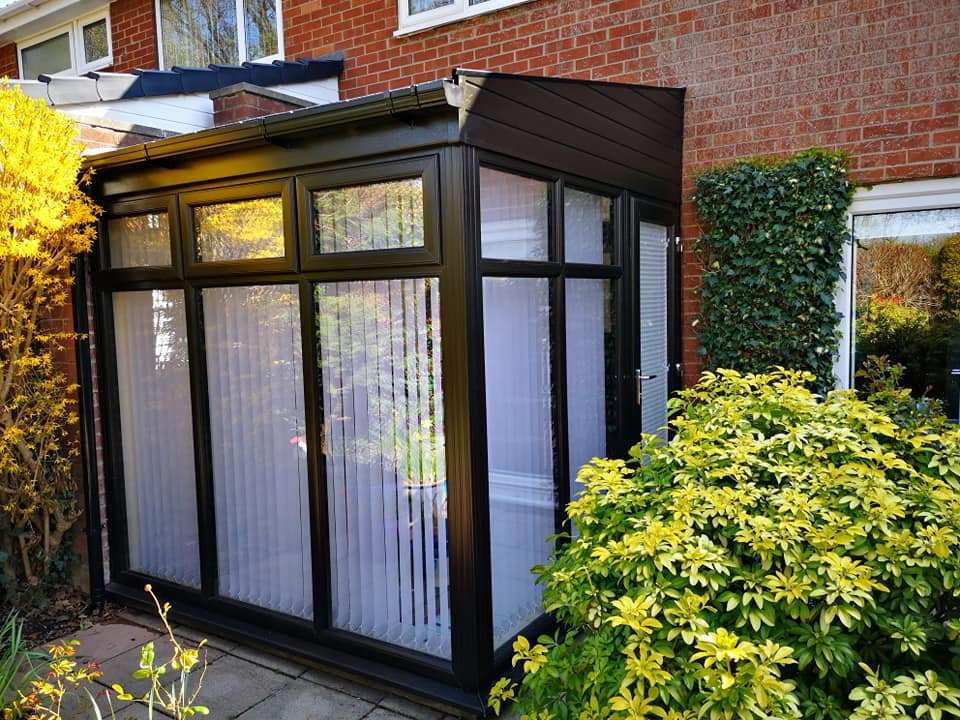 Lean to conservatory with a replacement tiled roof