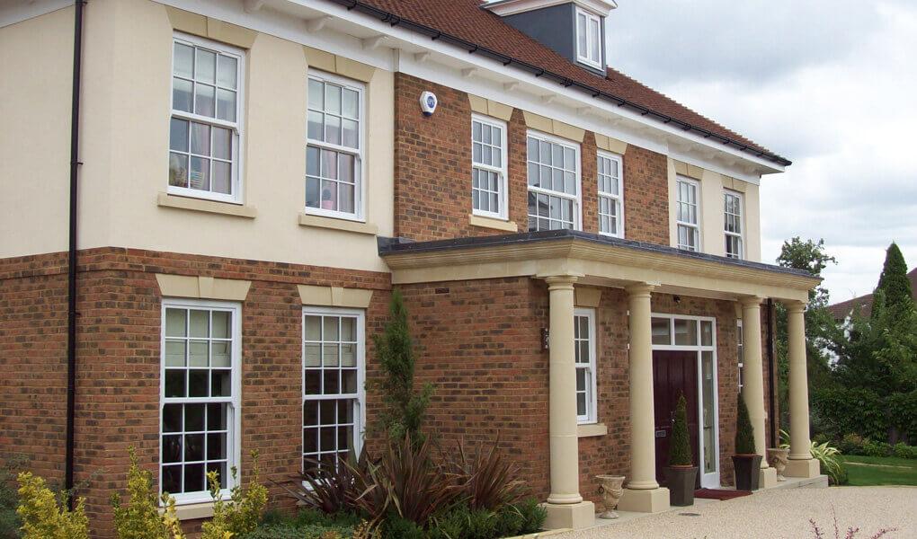 uPVC white windows on large house